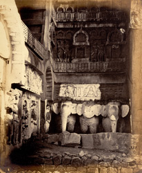 Side wall inside entrance to Chaitya Hall, Karli, showing donor figures, elephant sculptures and relief carvings of buildings and figures above 2243a